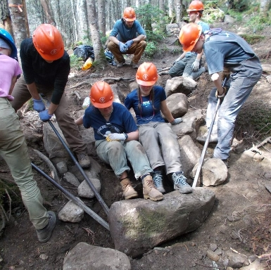 Members of one of our 1-Week crews setting a rock!