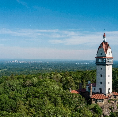 Heublein Tower was opened in 1914. It can be found at the top of Talcott Mountain State Park in Simsbury, Connecticut. On the left side of the the photograph you can see Hartford city skyline.