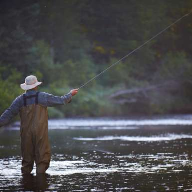 Fly fishing in pond near Little Lyford Lodge and Cabins