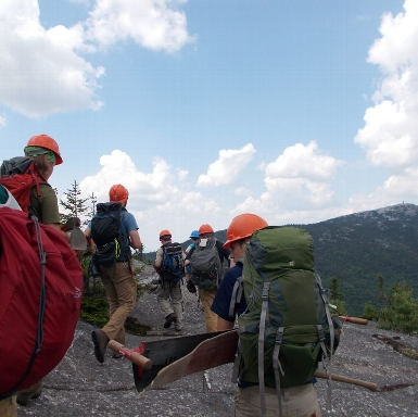 Our 2019 4-Week Crew doing a little hiking on their way to their project site.
